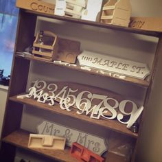 CNC carved rustic wooden table numbers and signs