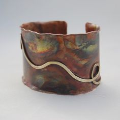 Cuff   Cyndie Smith. Copper, torch colored. and brass