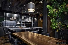 Atera Restaurant was designed by Parts and Labore in modern industrial style. Hand forged materials, walnut wood, porcelain, steel and gold fit nice to create a funky, but warm interior.