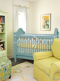 Yellow and blue nursery features blue crib dressed in yellow and blue crib bedding set, Annette Tatum Crib Bedding Set, situated under window dressed in white and blue polka dot valance accented with white and blue polka dot curtains.