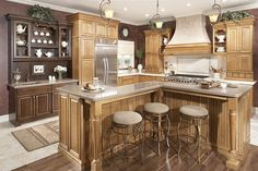 Medallion Cabinetry   I wonder how an L shaped island would work in my kitchen