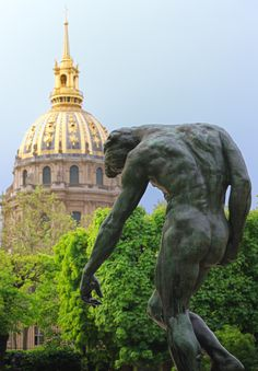Rodin statue leaning against the Invalides. Taken at the Rodin Museum, paris.