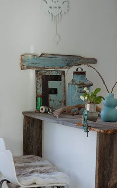 Rustic. worn wood made the desk and found objects as home decore