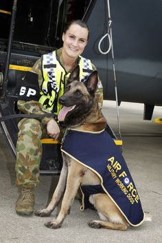 Military Working Dog Handler, Aircraftwoman Lauren Marshall with her dog Jeep on the flightline at RAAF Base Richmond.