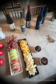 We love this decorative tablecloth idea for a festive wine-tasting party. Creative!