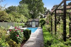 The house also landscaped gardens with a rose-covered arbour, an outdoor pool and pool hou...