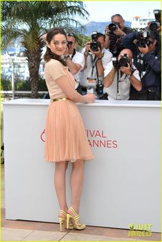 love this look on marion cotillard... also love that she doesn't dress like a prostitute