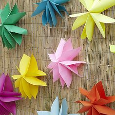Dress your fence by hanging paper flowers in tropical colors (instructions at www.allyou.com)