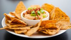 Blogger Angie McGowan of  Eclectic Recipes shares a cheesy bacon chip dip recipe.