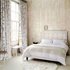 Relaxing bedroom; This effect, achieved by dragging a brush through wet glaze, creates a wonderfully textured backdrop. Sticking to a neutral colour scheme keeps the look soothing.