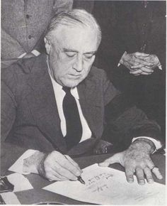 President  Roosevelt signing the declaration of war on Japan, Dec. 8, 1941.