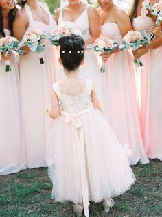 Pretty blush flower girl frock: http://www.stylemepretty.com/texas-weddings/2016/04/14/a-gorgeous-blush-texas-wedding-on-a-tight-budget/ | Photography: Tracy Enoch - http://www.tracyenoch.com/