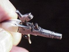 Antique miniature percussion single shot pistol, it is also the key for an antique key wind pocket watch!