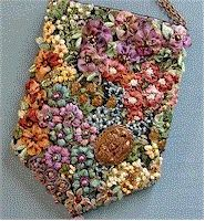 Crazy quilt embellished purse. Wow.  hmmmm i don't particularly like this BUT it is inspiring . . .