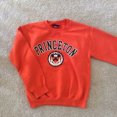 Princeton sweatshirt A comfy and iconic crewneck. Licensed college gear--purchased on-campus. Well-loved, but still in great condition. Tops Sweatshirts & Hoodies