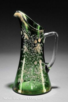 A Continental Enameled Emerald Glass Pitcher, late c., Moser, applied leaf and berries, height 12 in Vases, Crystal Glassware, Glass Pitchers, Carnival Glass, Carafe, Antique Glass, Vintage Glassware, Colored Glass, Pots