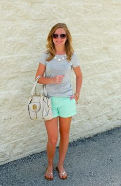 mint shorts, grey top and gold accessories