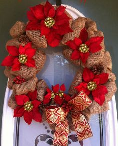 Create a unique and festive holiday DIY decoration this Christmas with this Poinsettia Burlap Wreath. Learn how to make a Christmas wreath with burlap and just a few other materials.