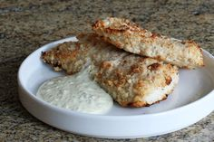Oven fried fish fillets are coated with a seasoned crumbs and panko crumbs. The fish is served with the included tartar sauce or remoulade sauce.
