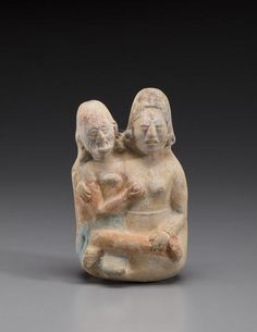 Maya Mold-Made Figure of God L with Consort, Jaina, Late Classic, ca. A.D. 550-950 The scene portrays the aged God L fondling the breast of a young noblewoman, part a narrative that appears with both figurines and painted on Maya vases including the famous codex style Princeton Vase