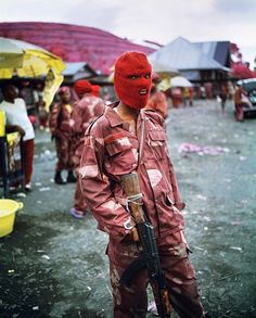 Richard Mosse http://www.jackshainman.com/artists/richard-mosse/  http://www.nytimes.com/interactive/2012/12/16/magazine/congo-color.html?_r=1&