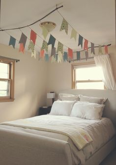 DIY flag canopy over bed. use branches to hang from the ceiling with twine. cut flags out of fabric or paper.  Bedroom decor, crafts, sewing