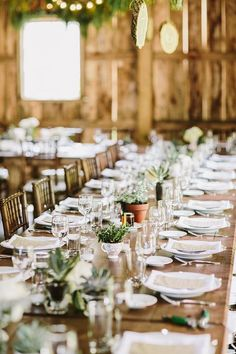 rustic green barn wedding table setting decor ideas / http://www.deerpearlflowers.com/barn-wedding-reception-table-decoration/