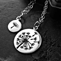 "Mother Daughter Dandelion Necklace Set     OR    Best Friends Necklace Set    Gorgeous deep impressions large dandelion and a smaller seed charm    You get TWO Necklaces on this one!    Both are sterling silver    Measurements: 1"" large and 14.5mm for seed charm"