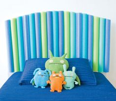 Kids headboard with swimming noodles... this would be cute for a reading corner with big pillows on the floor!