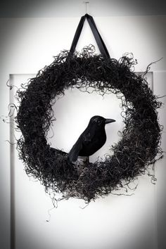 Black moss wreath for halloween