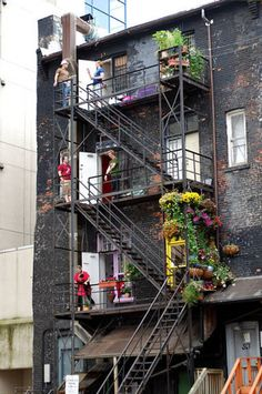Fire escapes! Like when we lived in New York in the 40's and where we slept out on hot nights during WWII. Written by original pinner.