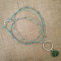 Chrysoprase drop and sterling silver ring pendant on a long aqua braided, beaded cotton cord necklace by MiiMyxJewelry on Etsy https://www.etsy.com/listing/225685778/chrysoprase-drop-and-sterling-silver