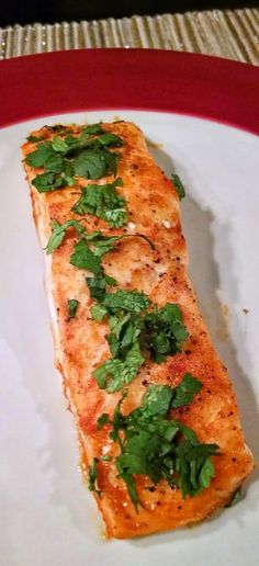 Flavorful Sriracha and Lime Salmon, topped with fresh cilantro. This recipe is unqiue, easy, and healthy!