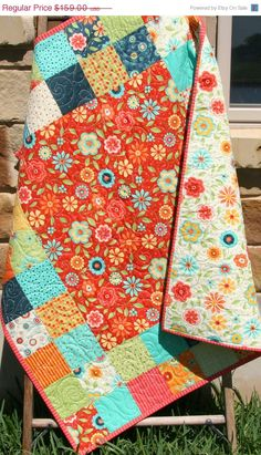 I like quilts for bedding too...sev?  Baby Girl Quilt, Patchwork Pink Blue Red Primary Colors, Crib Blanket, Nursery Decor, Bedding, Handmade Shower Gift, Flowers Block Party by SunnysideDesigns2 on Etsy https://www.etsy.com/listing/232976875/baby-girl-quilt-patchwork-pink-blue-red