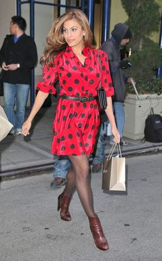 Eva Mendes looks pretty in a polka dot dress and textured tights while out and about in New York.