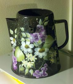 Flower coffee pot ~ Not a place setting, but a matching set would be lovely.