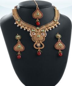 Exclusive bridal polki jewelry set hand crafted in a gold background with Emerald,Ruby and White polki stones studded-04PLKA03  http://www.craftandjewel.com/servlet/the-1842/Indian-jewelry-necklace-designs/Detail