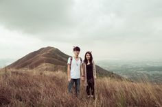 High-Res Stock Photography: young couple is on the mountain
