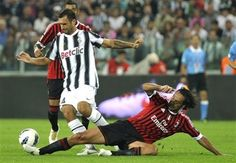 Juventus striker Mirko Vucinic of Montenegro, left, is tackled by AC Milan defender Alessandro Nesta during a Serie A soccer match at the Juventus Stadium in Turin, Italy, Sunday, Oct. 2, 2011. (AP Photo/Massimo Pinca)