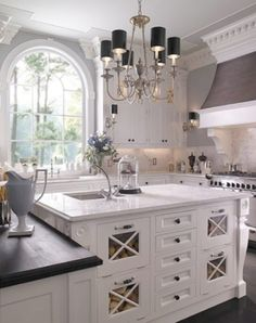 Elegant kitchen. Love the tall ceilings, arched window, classic feel. Chandelier with black shades!