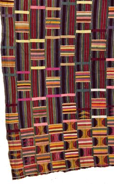 Africa | Detail from a 'Kente' cloth from the Ewe people of Ghana | Cotton; narrow strip loom | Mid 20th century || Partial view