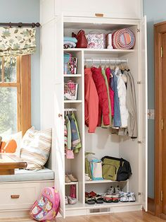 mudroom - Conceal Clutter  Keep clutter hidden with a coat closet near the entry. Here a coat closet extends to the ceiling, maximizing the available space and ensuring plentiful storage for shoes, coats, bags, hats, and gloves. In addition, the coat closet offers bins and hooks at varying heights to accommodate both children and adults.