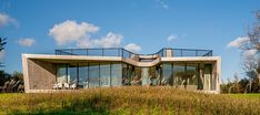 KELLER minimal windows, large-scale frameless sliding windows for floor-to-ceiling transparency, made-to-measure sliding windows