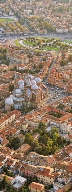 Aerial view of inner city Padua, Italy with Prato della Valle square and St. Anthony Basilica • photo: vesilvio on ShuttleStock
