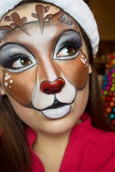 Awesome red-nosed reindeer face painting. Great facepainting idea for Christmas!