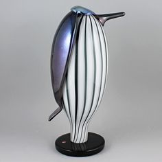"Oiva Toikka's brilliant ""Butler"" (Hovimestari) glass bird with rounded form, polychrome color, and joyous expression. Mouth-blown and hand crafted glass art from Iittala in Finland. Glass Birds, Butler, Glass Art, Sculpture, Crafts, Stuff To Buy, Color, Scandinavian, Design"