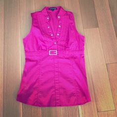 Express cute pink shirt! This shirt is perfect for work or a night out! Perfect and like new- the size says XS but it fits like a small- I'm a small in every other store Express Tops