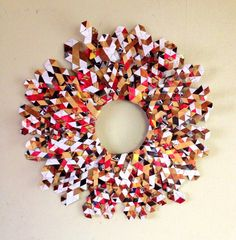 Recycled wreath made from discontinued Fresh Gallery Otara brochures, made for the Fresh Art Market (December Ornament Wreath, Ornaments, December 2013, How To Make Wreaths, Brochures, Art Market, The Fresh, Reuse, Recycling