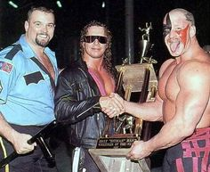 "The Big Boss Man, Bret ""Hitman"" Hart, and Hawk: 1993  I believe that's the Hitman's Pro Wrestling Illustrated ""Wrestler of the Year"" trophy. Awesome."