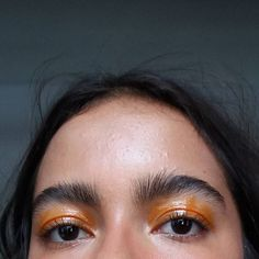 Orange lip gloss as eye shadow